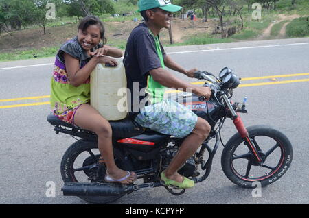 Maicao, Colombia. 5th Sep, 2017. A young couple of the Wayuu indigenous tribe can be seen on their motorcycle transporting - Stock Photo