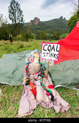 Nimbin, Australia. 7th October, 2017. A large doll, in front of the sacred Nimbin Rocks, used at a protest against - Stock Photo
