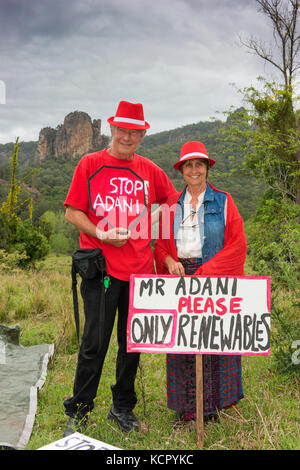 Nimbin, Australia. 7th October, 2017. A man and woman protesting against coal and Adani's Queensland Carmichael - Stock Photo