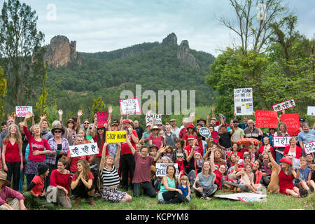 Nimbin, Australia. 7th October, 2017. Protesters against coal and Adani's Queensland Carmichael coal mine pose for - Stock Photo