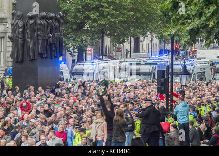 London, UK. 7th Oct, 2017. Thousands of supporters representing various English football clubs march down Whitehall - Stock Photo