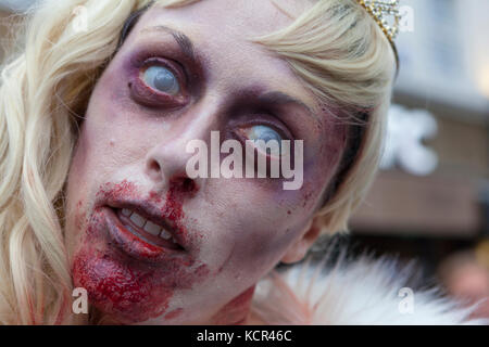 London, UK. 7th Oct, 2017. World Zombie Day, hundreds of blood smeared Zombies groaned and shambled their way through - Stock Photo