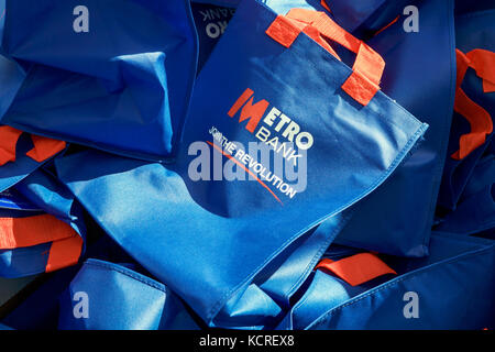 Metro Bank, Join The Revolution, blue bags. - Stock Photo