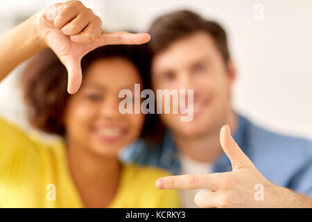 happy couple hands making frame gesture - Stock Photo
