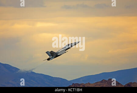 In this shot a U.S. Navy E/F-18F Super Hornet performs at the Historic Wendover Airfield Air Show in Wendover, Utah, - Stock Photo