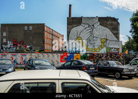 BERLIN-MAY 31: famous graffiti called Chain by artist Blu in the Friedrichshain-Kreuzberg district,on May 31,2011. - Stock Photo