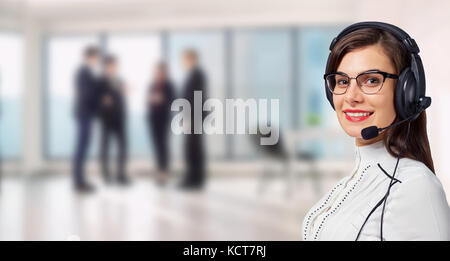 Woman call center operator in headset on business office backgro - Stock Photo