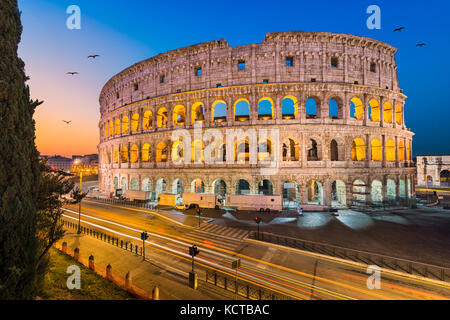 Colosseum in Rome, Italy at night - Stock Photo