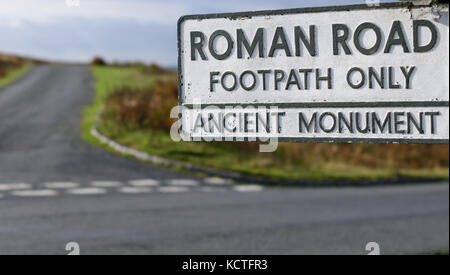 Signpost to an ancient Roman road on Wheeldale Moor. - Stock Photo