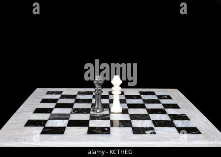 Who is the winner. King vs king on a marble chess board - Stock Photo