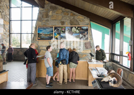 Park rangers giving information to the park visitors / tourists on the current conditions at the Logan Pass Visitor - Stock Photo
