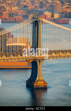 Aerial view of a tower of the Manhattan Bridge spanning Brooklyn and Manhattan in New York City - Stock Photo