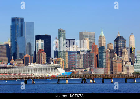 Norwegian Breakaway Cruise ship in Hudson River with the skyline of Lower Manhattan financial district in the background.New - Stock Photo