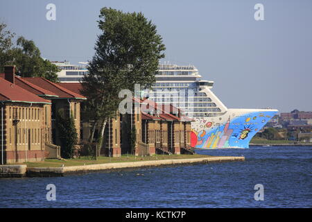Norwegian Breakaway Cruise Ship in Hudson River with Ellis Island in foreground. New York City,New Jersey.New York.New - Stock Photo