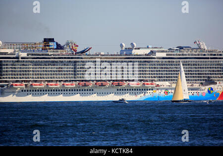 Norwegian Breakaway Cruise Ship in Hudson River with sailboat in foreground.New York City.USA - Stock Photo