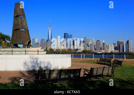 Columbus Monument at Liberty State Park in Jersey City with the view of skyline of Lower Manhattan in the background.New - Stock Photo