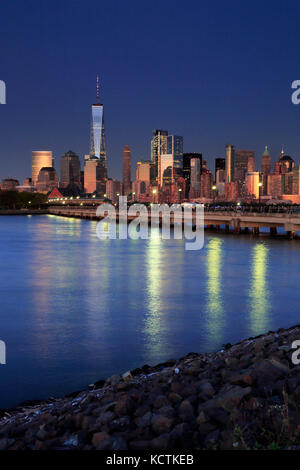 The night view of Lower Manhattan skyline with One World Trade Center tower in Financial District and Brooklyn.Manhattan,New - Stock Photo