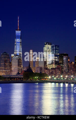 The night view of Lower Manhattan skyline with One World Trade Center tower in Financial Distric and Brooklyn.Manhattan,New - Stock Photo