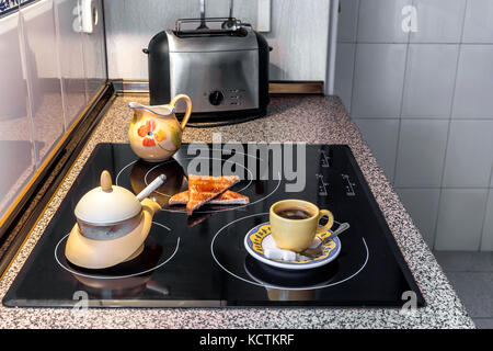 breakfast with coffee and toast  ready to eat in the kitchen - Stock Photo