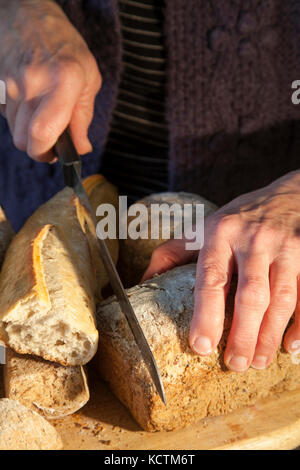 Cutting a home made loaf - Stock Photo
