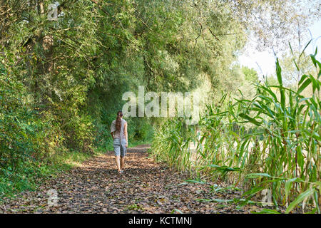 Woman in Munich, September 24, 2017 Woman in psychological crisis and depression walking in the forest on September - Stock Photo