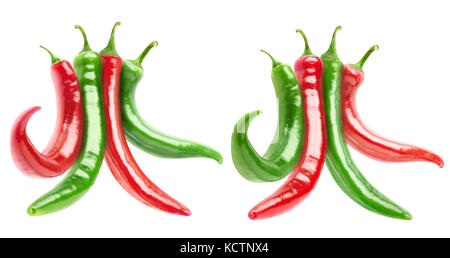Isolated mixed peppers. Two bundles of hot red and green peppers isolated on white background with clipping path - Stock Photo