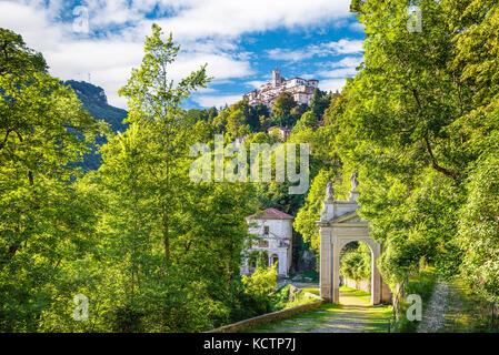 Sacro Monte of Varese (Santa Maria del Monte), Italy. Via Sacra that leads to medieval village (in the background), - Stock Photo