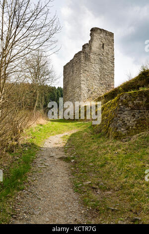 View of a ruined tower of the castle Oberburg Manderscheid in the Eifel, Germany in spring. - Stock Photo
