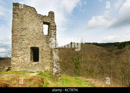 View of a ruined building of the castle Oberburg Manderscheid in the Eifel, Germany in spring. - Stock Photo