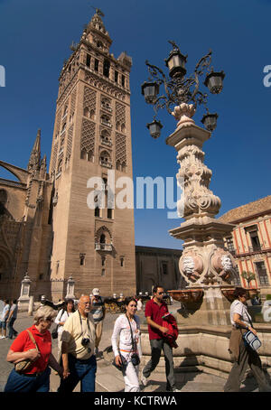 The Giralda and tourists, Seville, Region of Andalusia, Spain, Europe - Stock Photo