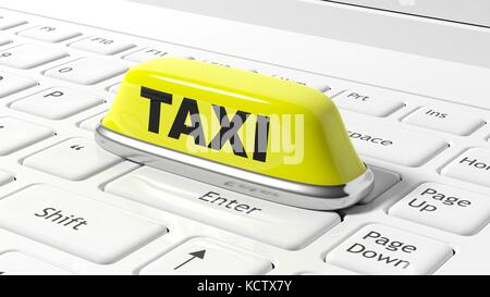 Yellow taxi car roof sign on white laptop keyboard - Stock Photo
