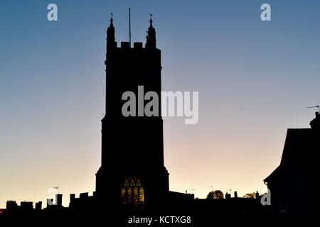 St John's Church in Glastonbury Somerset UK early in the morning short long exposure. Street light shinning. - Stock Photo