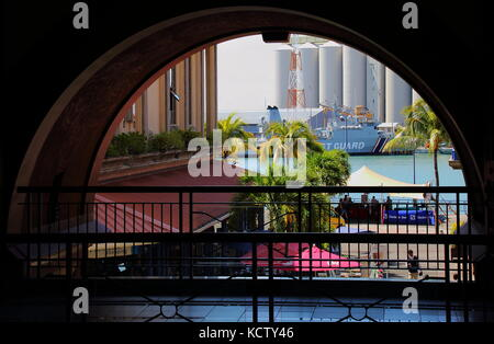 Port Louis, Mauritius - a glimpse of the harbor from the Le Caudan Waterfront in the capital city of the Indian - Stock Photo