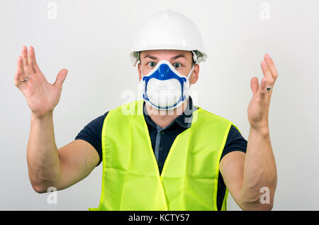 Workman In Protective Mask And Body Suit Ready To Remove