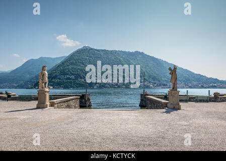 Como, Italy - May 27, 2016: Statues along the public walkways in the historic Lake Como district in Como city, Italy. - Stock Photo