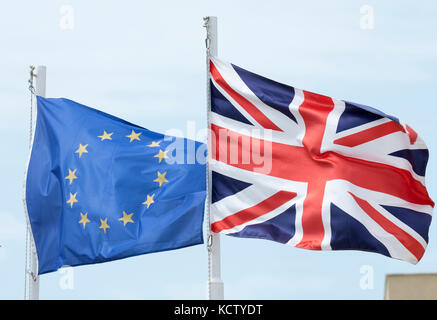 The European Union and British (Union Jack)  flags fly side by side in Cyprus. - Stock Photo