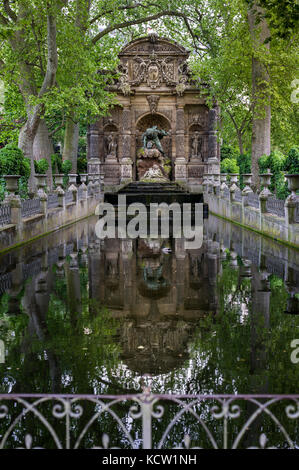 The Medici Fountain (fr La fontaine Médicis), a monumental fountain in the Jardin du Luxembourg in the 6th arrondissement - Stock Photo
