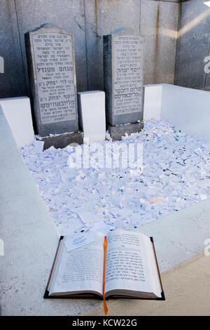 A book of Psalms at the site of the burial of the last 2 Lubavitcher Rebbes. In Montefiore Cemetery in Cambria Heights, - Stock Photo