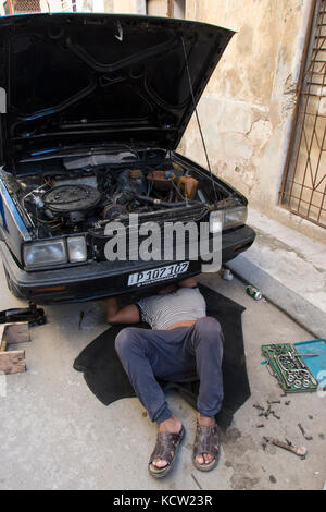 Typical street repair of car, Habana Vieja, Old Havana,  Cuba - Stock Photo