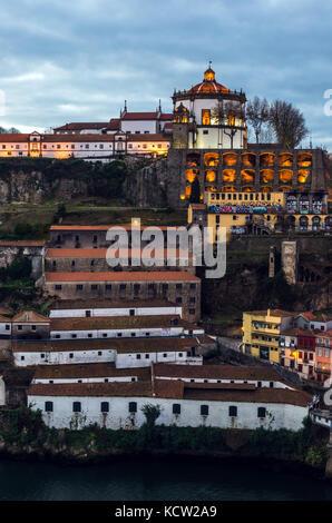 Monastery of Serra do Pillar above Port wine cellars on the bank of Douro River in Vila Nova de Gaia city, Portugal. - Stock Photo