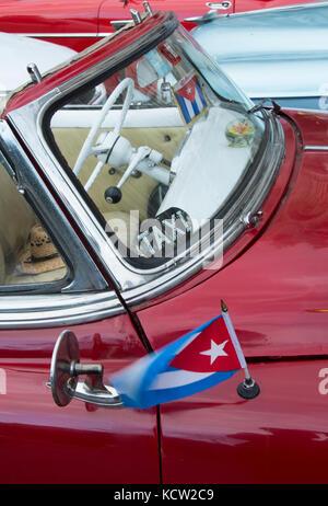 Classic american car with Cuban Flag, Havana, Cuba - Stock Photo