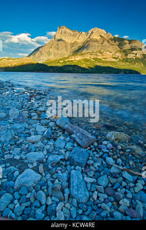 Evening light at Waterton Lakes and Vimy Peak (Ridge). Vimy Peak is the front range mountain standing east of the - Stock Photo