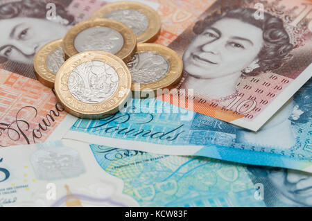New UK currency, 10 pounds, 5 ponds, 1 pound coins - Stock Photo