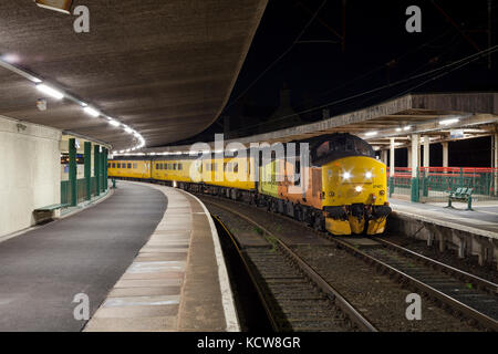 A Colas Railfreight class 37 locomotive at Carnforth (Lancashire)  with the Network Rail Plain line pattern recognition - Stock Photo
