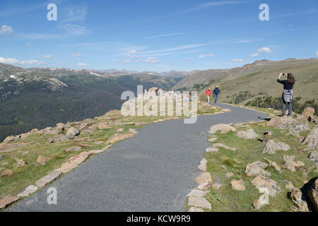 Visitors at Rainbow Curve viewpoint, Rocky Mountain National Park, Colorado - Stock Photo