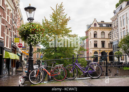 Bikes parked on a street near the Oudegracht (Old Canal) in central Utrecht, Netherlands - Stock Photo