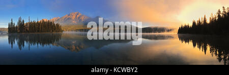 Panorama of Pyramid Lake at sunrise, Jasper National Park, Alberta, Canada - Stock Photo