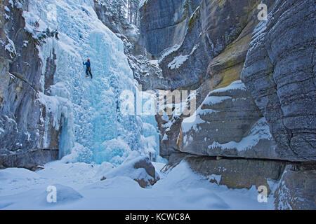 Ice climber in Maligne Canyon, Jasper National Park, Alberta, Canada - Stock Photo
