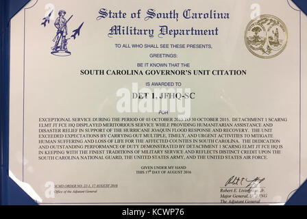 U.S. Soldiers with Detachment 1, Joint Force Headquarters, South Carolina Army National Guard, receive a S.C. Governor's - Stock Photo