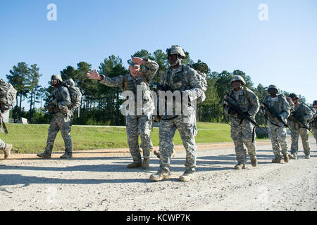 U.S. Soldiers assigned to the Florida Army National Guard conduct a 12 mile ruck march with 218th Regiment (Leadership), South Carolina Army National Guard 12 Bravo Combat Engineer instructors at McCrady Training Center, in Eastover, S.C. April 4, 2016.  The ruck march is part of the combat engineer military occupation specialty retraining for soldiers transitioning to the 12 bravo career field, this class was the first to train women going into the career field at McCrady. (U.S. Air National Guard photo by Tech. Sgt. Jorge Intriago)